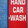 Stock Photo: Bright red hand car wash sign
