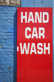 Bright red hand car wash sign — Stock Photo