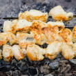 Many roast meat pieces get on skewer. shish kebab cooking — Stock Photo
