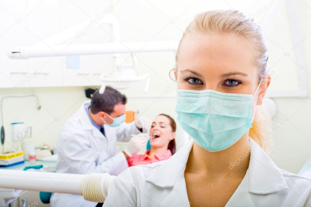 Happy confident female dentist  Stock Photo #10742900
