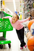 Little girl in supermarket — Stock Photo