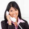 Friendly receptionist on phone — Stock Photo