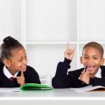 Cute elementary school kids in classroom — Stock Photo #10983345