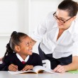 Primary school teacher and pupil - Stock Photo