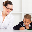 Primary school teacher and pupil — Stock Photo