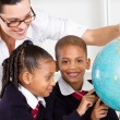 Royalty-Free Stock Photo: Elementary geography teacher and students