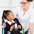 Friendly teacher talking to elementary student — Stock Photo