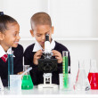 Elementary school kids in science class - Stock Photo