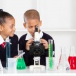 Elementary school kids in science class — Stock Photo
