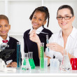 Primary school students and teacher in science class — Stock Photo