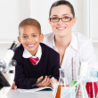 Elementary science teacher and student — Stock Photo