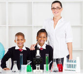 Portrait of primary teacher and students — Stock Photo