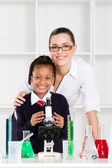 Science teacher and schoolgirl in lab — Stock Photo