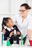Friendly teacher talking to elementary student — Stock Photo