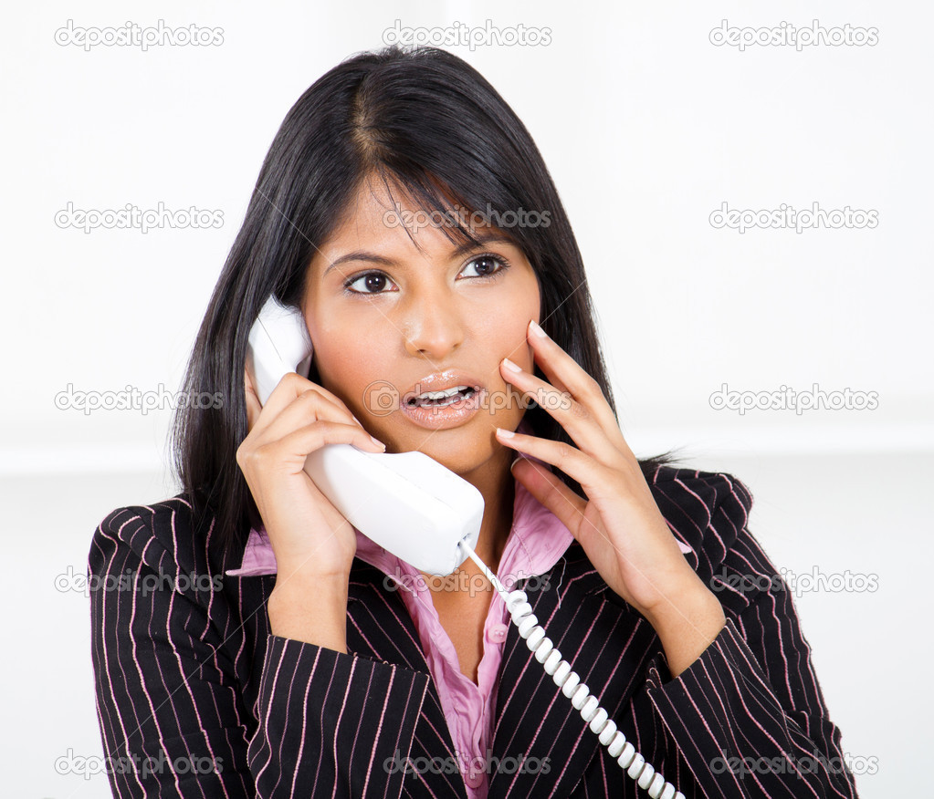 Young businesswoman shocked by phone call — Stock Photo #10981004
