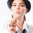 Beautiful woman dressing in man's clothing holding a cigar - Stock Photo