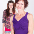 Happy teenager girl and middle aged mother — Stock Photo
