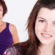 Happy teen girl and middle aged mother — Stock Photo