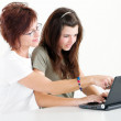 Middle aged mother help teen daughter study — Stock Photo