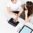 Teen girl talking to mother in front of her desk — Stock Photo #11102110