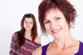 Happy middle aged mother and teen girl — Stock Photo