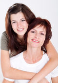 Happy mother and teen daughter — Stock Photo