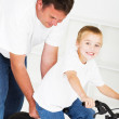 Father teaching son how to ride a bicycle — Stock Photo