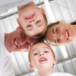 Happy family of four look down — Stock Photo
