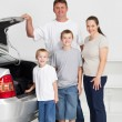 Happy family ready for a fun road trip - Stock Photo