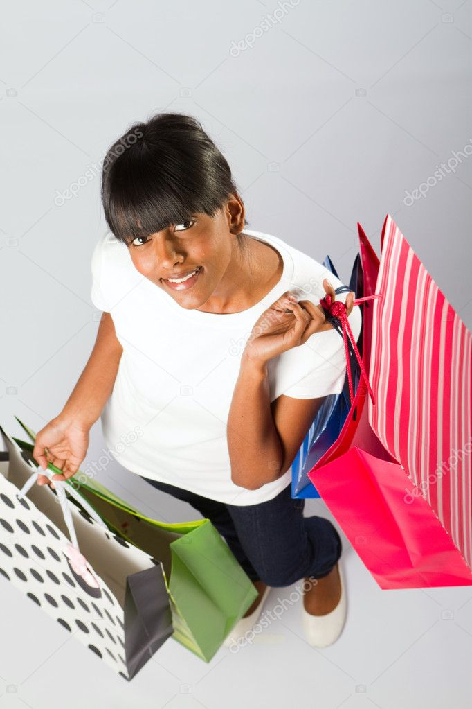 Overhead view of young indian woman with shopping bags — Stock Photo #11139511