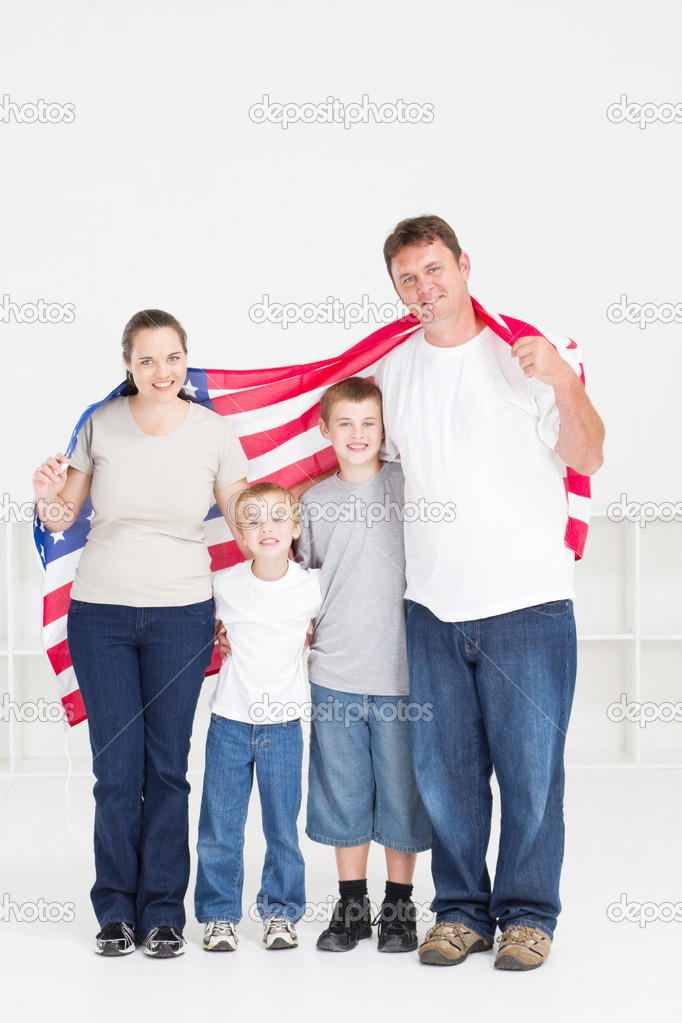 American family of four with USA flag  Stock Photo #11139880