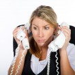 Businesswoman dealing with a lot of phone calls at same time — Stock Photo #11140986