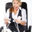 Stressed young businesswoman - Stock Photo