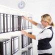 Young businesswoman searching files — Stock Photo #11141004
