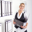 Young happy businesswoman in office — Stock Photo #11141022