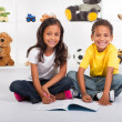 Stock Photo: Brother and sister drawing on book