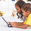 African american brother and sister playing laptop computer — Stock Photo