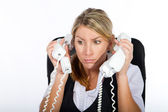 Businesswoman dealing with a lot of phone calls at same time — Stock Photo
