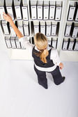 Young businesswoman searching files — Stock Photo