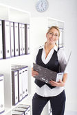 Young happy businesswoman in office — Stock Photo