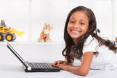 Indian girl playing with laptop — Stock Photo