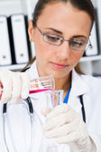 Young medical scientist doing researching — Stock Photo