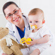 Pediatrician and baby patient — Stock Photo