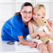 Stock Photo: Nurse and little girl patient