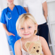 Stock Photo: Little girl and mother in doctor's office