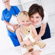 Mother and little girl in doctor's office — Stock Photo #11158522