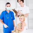 Royalty-Free Stock Photo: Doctor, nurse and little patient