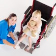 Stock Photo: Doctor bandage little patient's ankle