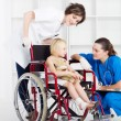 Doctor, nurse and little girl patient — Stock Photo