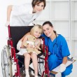 Doctor, nurse and little girl patient — Stock Photo #11158565